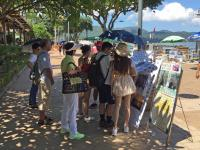 Signing up for boat trips, Sai Kung waterfront
